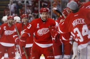Detroit Red Wings center Pavel Datsyuk (13) celebrates his goal against the Carolina Hurricanes in the third period of an NHL hockey game in Detroit Tuesday, April 7, 2015. (AP Photo/Paul Sancya)